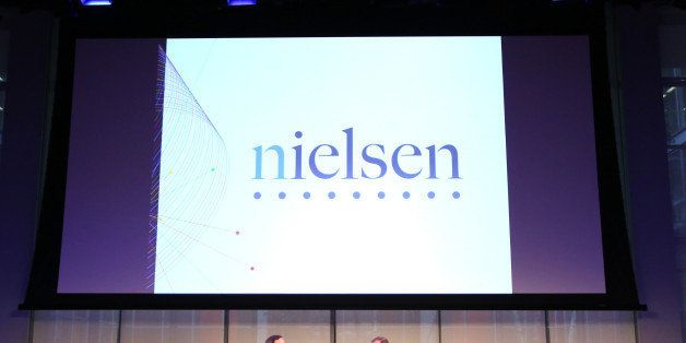 NEW YORK, NY - SEPTEMBER 30:  Senior Correspondent at CBS News, Anthony Mason (L) and CEO at Nielsen, Mitch Barns speak onsta
