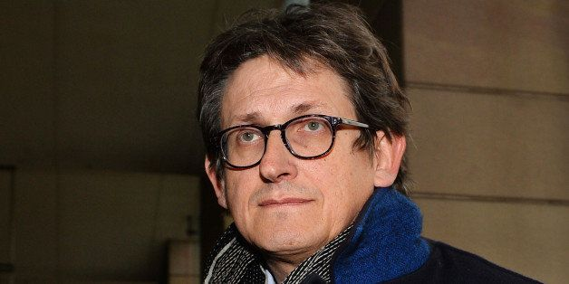 The editor of Britain's Guardian newspaper, Alan Rusbridger, arrives at Portcullis House in London on December 3, 2013, to ap
