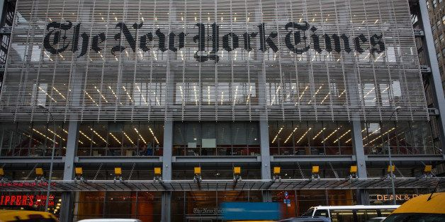 NEW YORK, NY - OCTOBER 01:  Traffic drives past The New York Times building on October 1, 2014 in New York City. The Times an