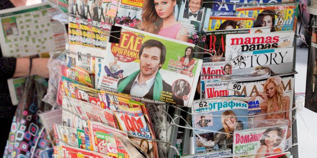 MOSCOW, RUSSIA - JUNE 19: Close-up of magazines and newspapers in a newspaper rack on June 19, 2012, in Moscow, Russia. Photo