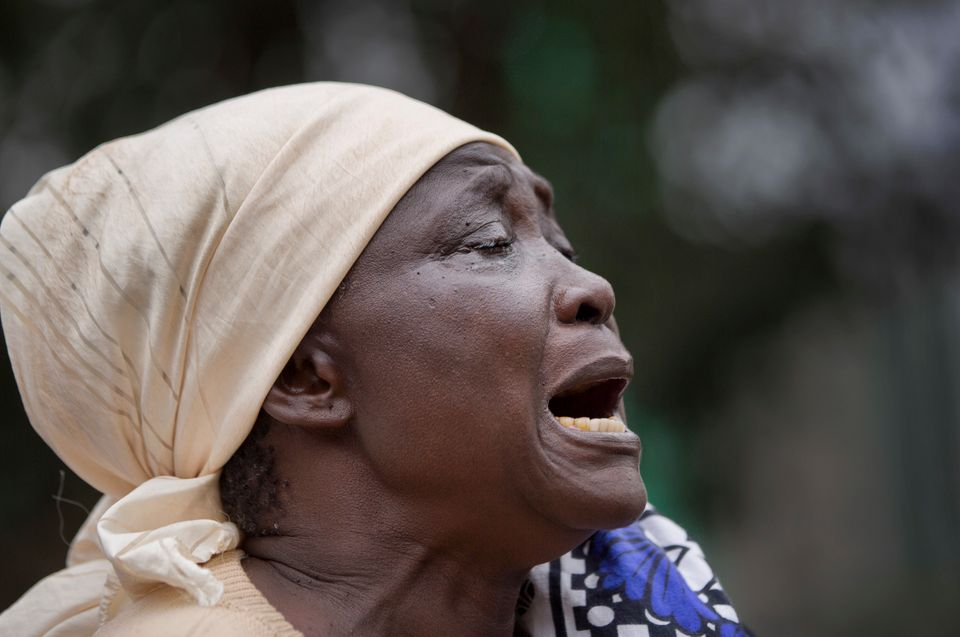 Mary Italo grieves for her son Thomas Abayo Italo, 33, who was killed in the Westgate Mall attack, as she waits to receive hi