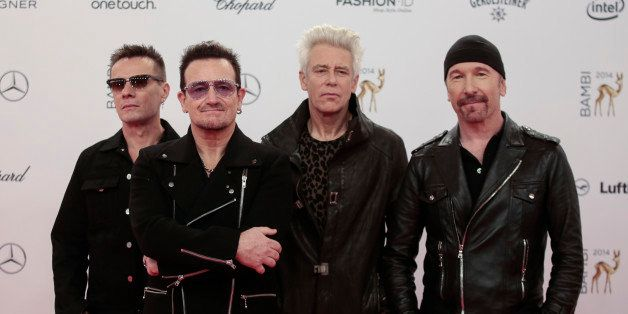 The members of Irish band U2 from left, Larry Mullan jr., Bono,  Adam Clayton and The Edge arrive for the Bambi 2014 media aw