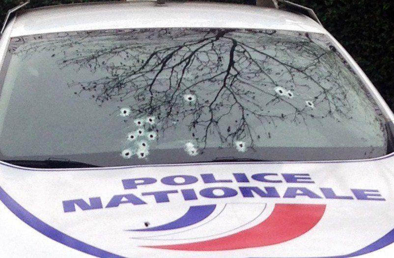 A photo taken on January 7, 2015 shows a police car riddled with bullets during an attack on the offices of the newspaper Cha