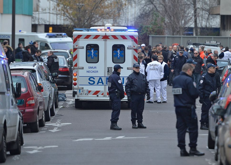 Ambulances and police gather at Charlie Hebdo offices after a deadly attack on the french satirical magazine on January 7, 20