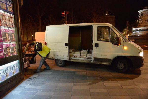 A van brings the first delivery of the new edition of Charlie Hebdo magazine at Place de la Republique on January 14, 2014 in