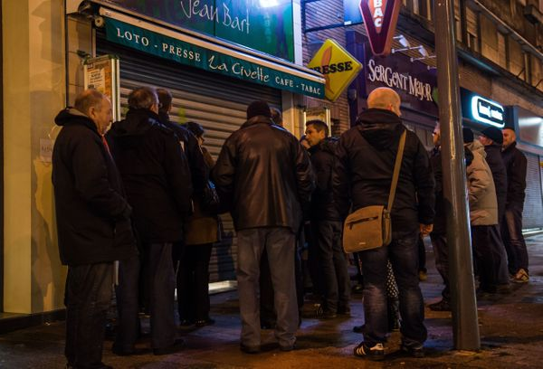 People wait outside a newsagents in Dunkirk on January 14, 2015 as the latest edition of French satirical magazine Charlie He