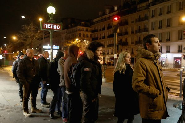 Parisians queue at a newspaper kiosk to get their copies of the latest edition of Charlie Hebdo magazine on January 14, 2015