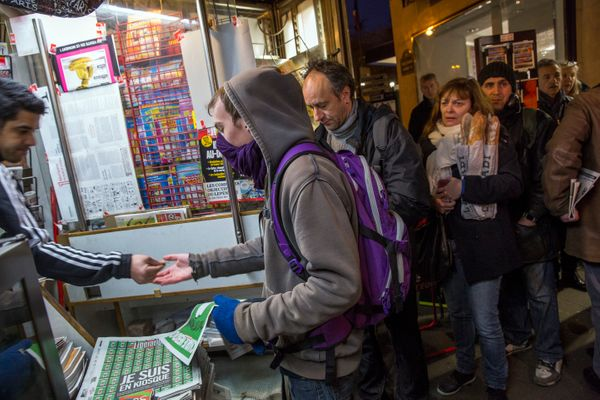 Parisians buy copies of the latest edition of Charlie Hebdo magazine on January 14, 2015 in Paris, France. Five million copie