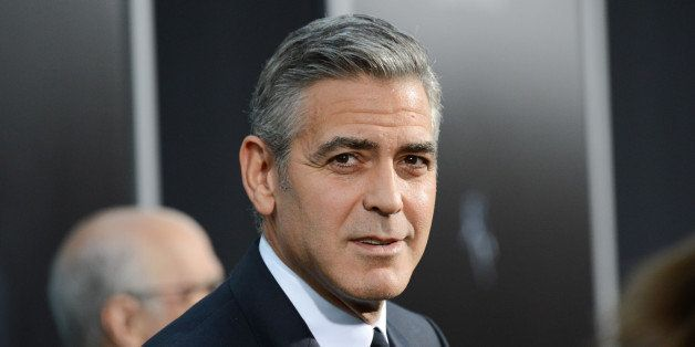 "FILE - In this Oct. 1, 2013 file photo, actor George Clooney attends the premiere of ""Gravity"" at the AMC Lincoln Square Thea"