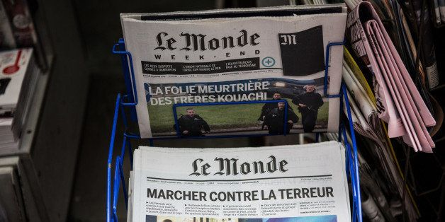 PARIS, FRANCE - JANUARY 10:  A copy of 'Le Monde' and the 'Courier International' with front page reports on this weeks' terr