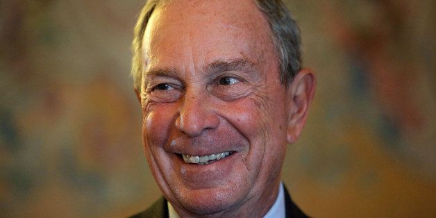 FILE - In this Tuesday, Sept. 16, 2014 file photo, former New York Mayor Michael Bloomberg smiles prior to be conferred with