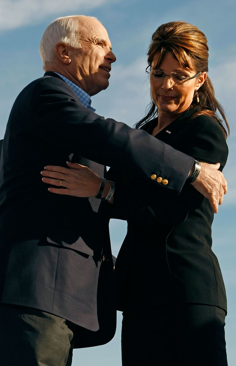 Republican presidential nominee John McCain embraces his running mate Sarah Palin during a campaign rally at the Green High S