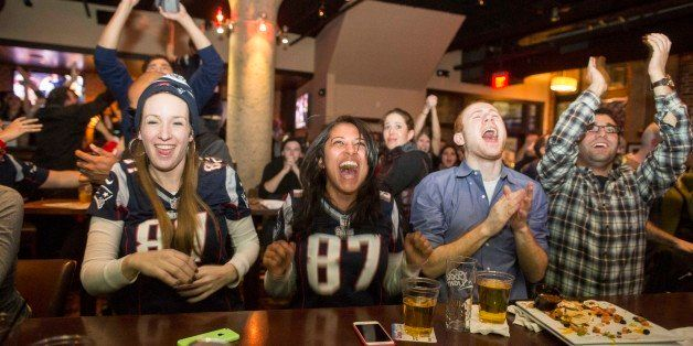 OSTON, MA - FEBRUARY 1:  New England Patriots fans cheer after the  Patriots defeated the Seattle Seahawks in Super Bowl XLIX