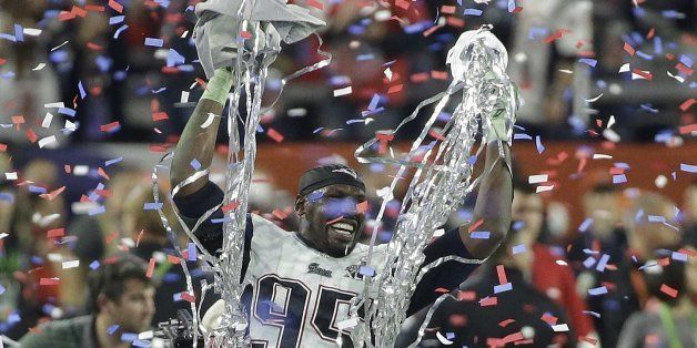New England Patriots defensive end Chandler Jones (95) celebrates after the Patriots beat the Seattle Seahawks in the NFL Sup