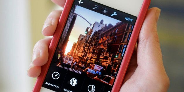 This Monday, June 9, 2014 photo shows the Instagram app, featuring new editing tools, on an iPhone posed for a photo in New Y
