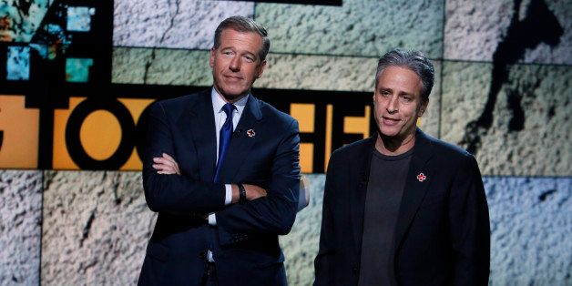 "In this photo provided by NBC, Brian Williams, left, and Jon Stewart appear during ""Hurricane Sandy: Coming Together"" Friday,"