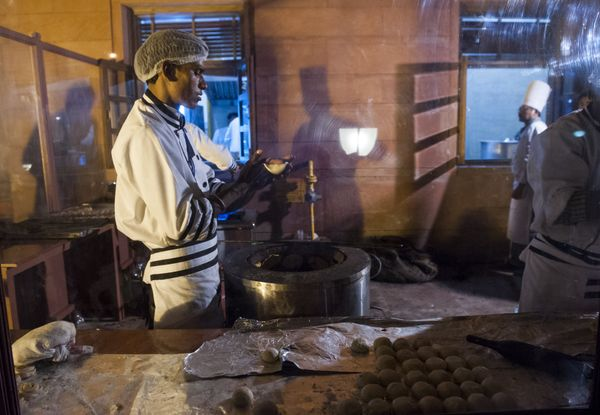 Cooks preparing food outside for a State Dinner in honor of US President Barack Obama at Rashtrapati Bhawan, the Presidential