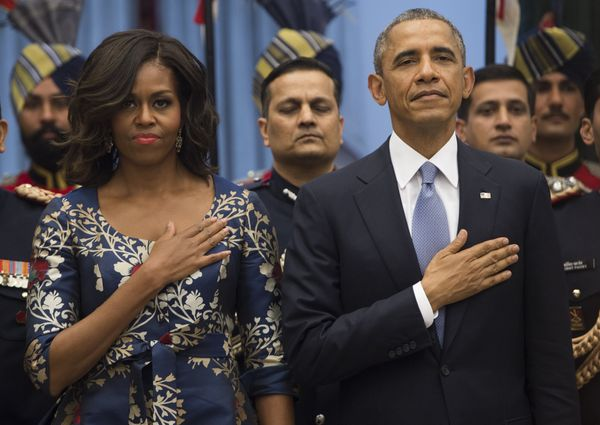 US President Barack Obama and First Lady Michelle Obama stand for the American National Anthem prior to participating in a re