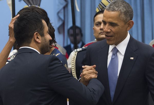 US President Barack Obama greets actor Kal Penn during a receiving line before a State Dinner at Rashtrapati Bhawan, the Pres