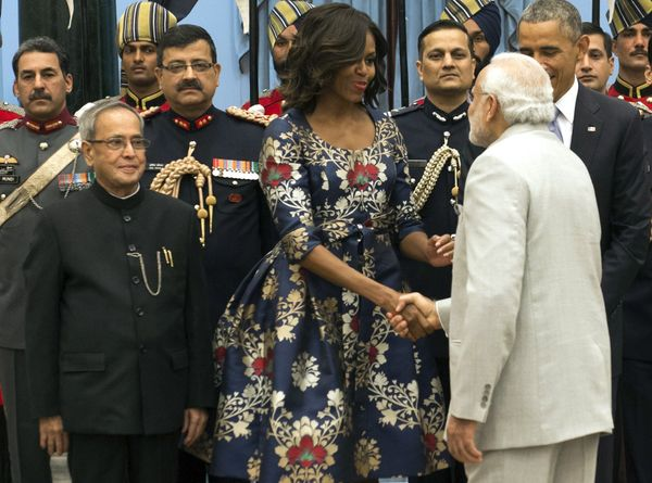 Indian President Pranab Mukherjee stands alongside US President Barack Obama and First Lady Michelle Obama as they greet Indi