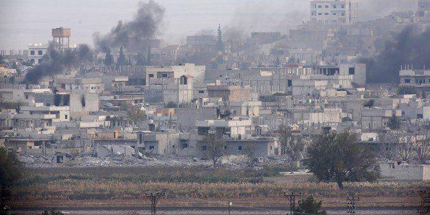 SANLIURFA, TURKEY - NOVEMBER 14: Smoke, rising from Kobani (Ayn al-Arab) town of northern Syria during the missile and mortar