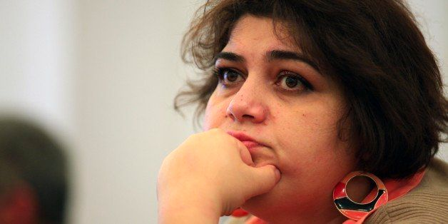 This photo taken Sunday, March 2, 2014, shows Azerbaijani Khadija Ismayilova, a reporter for Radio Free Europe/Radio Liberty,