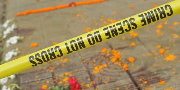 DHAKA, BANGLADESH - 2015/02/27: The spot of the murder marked with large dry pool of blood is cordon off by police. Blogger A