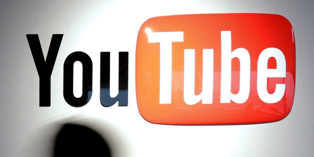 A woman walks past Google Inc.'s YouTube logo displayed at the company's YouTube Space studio in Tokyo, Japan, on Saturday, M