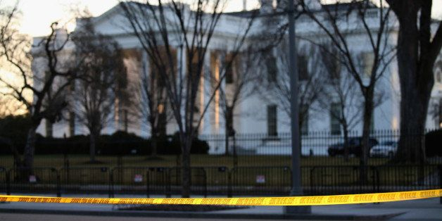 WASHINGTON, DC - MARCH 12: Yellow police tape is stretched across Pennsylvania Avenue in front of the White House, on March 1