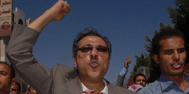 Yemeni opposition journalist Abdel Karim al-Khaiwani joins a protest calling for the ouster of Yemen's President Ali Abdullah