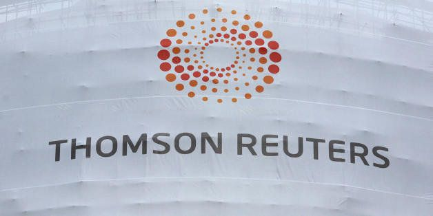A new temporary sign is displayed on the Thomson Reuters building in Canary Wharf in London, on April 17, 2008. Thomson Reute