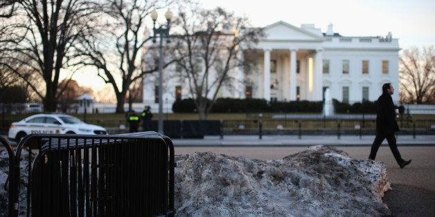 WASHINGTON, DC - MARCH 12:  Melting snow and barricades sit in front of the White House on March 12, 2015 in Washington, DC.