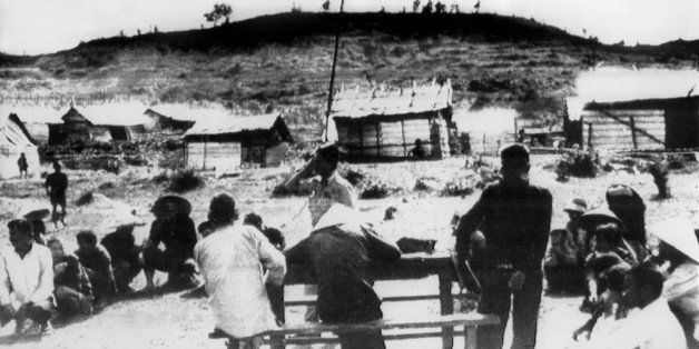 The Vietnamese flag flies over the village of Mai Lai 19 November 1969, where some 600 villagers were allegedly massacred by