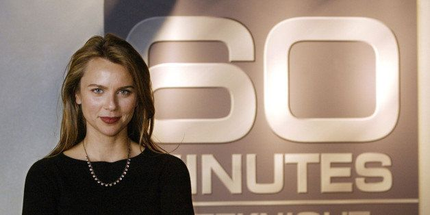 """CBS News correspondent Lara Logan poses in front of a sign for """"60 Minutes"""" at the CBS Broadcast Center in New York Dec. 16,"""