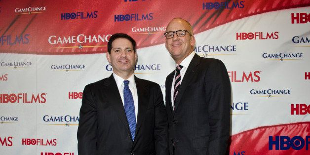 WASHINGTON, DC - MARCH 08: Mark Halperin and John Heilemann pose on the red carpet during the 'Game Change' premiere at The N