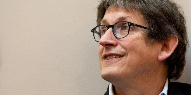 Guardian newspaper editor Alan Rusbridger is pictured before the start of a press conference in London, on December 2, 2013,