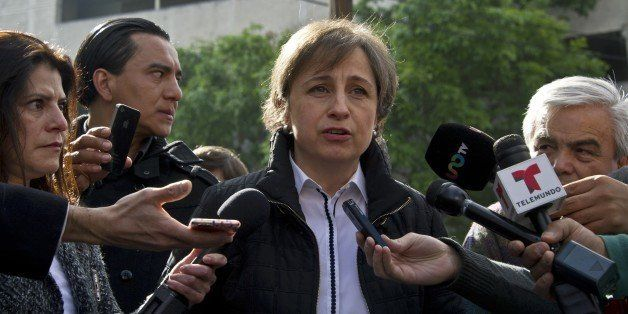 Mexican journalist Carmen Aristegui speaks to the press in Mexico City on March 16, 2015 a day after being fired. Aristegui,