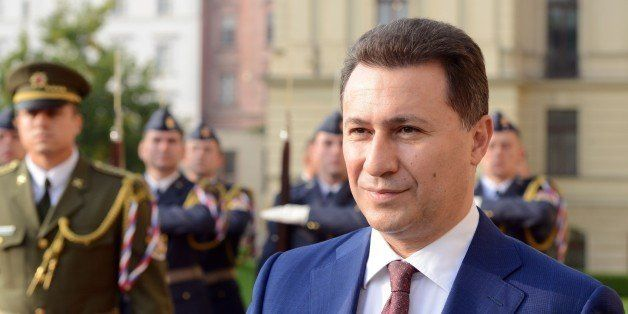 Macedonian Prime Minister Nikola Gruevski reviews a guard of honour during a welcoming ceremony a meeting with his Czech coun