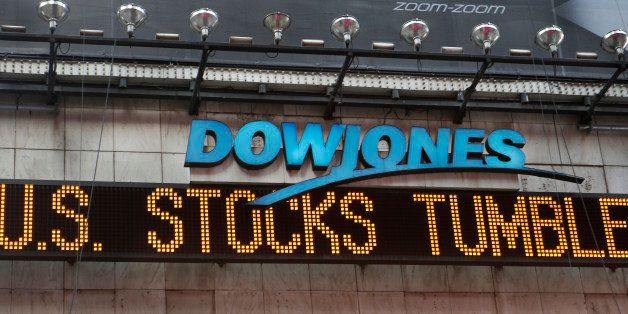A zipper on the side of One Times Square announces a stock selloff on Wall Street in New York, Wednesday, Oct. 15, 2014. A mo