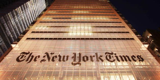 The New York Times building is shown Wednesday, Oct. 21, 2009 in New York. The New York Times Co. is reporting a loss for the
