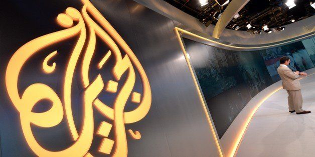 The Al Jazeera logo is seen in the new Al Jazeera America television broadcast studio on West 34th Street August 16, 2013 in
