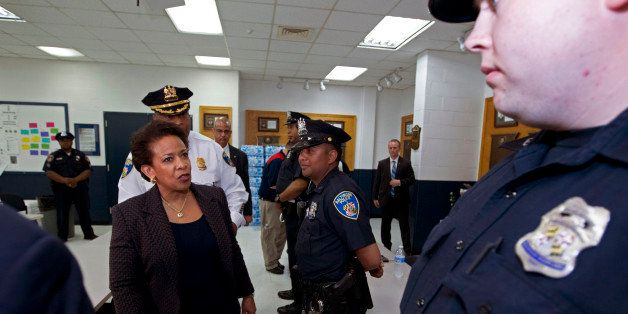 Attorney General Loretta Lynch meets with Baltimore police officers during a visit to the Central District of Baltimore Polic