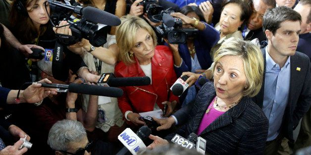 Democratic presidential candidate Hillary Rodham Clinton speaks to reporters after a round table discussion at Smuttynose Bre