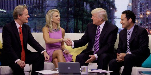 Elisabeth Hasselbeck appears with co-hosts Steve Doocy, left, and Brian Kilmeade, right, as Donald Trump is interviewed durin