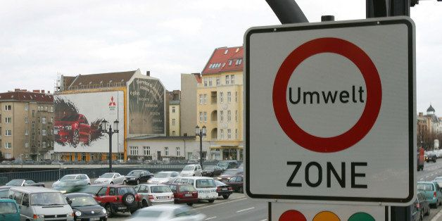 BERLIN - NOVEMBER 27:  Cars pass a sign, environmental zone, indicating the new pollution class for cars on November 27, 2007