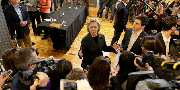 Democratic presidential candidate Hillary Rodham Clinton speaks to members of the media after meeting with small business own