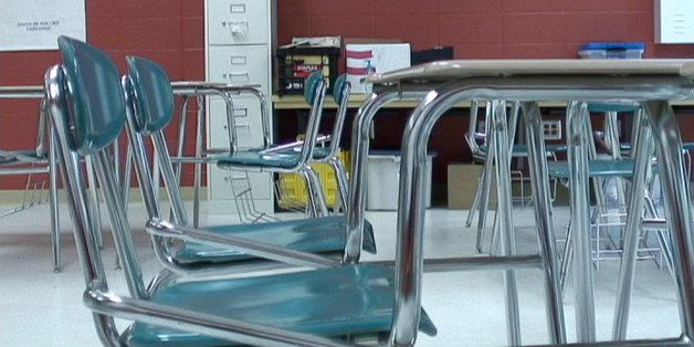 In this image made from video, chairs sit empty in a classroom of Hunt Elementary School in Fort Valley, Ga., on Monday, May