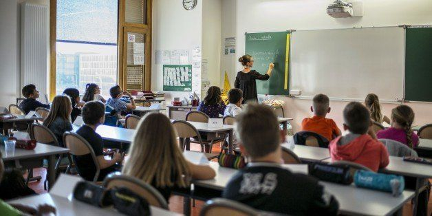 Pupils work in their classroom of a elementary school on September 2, 2014 in Lyon, on the first day of the French new school