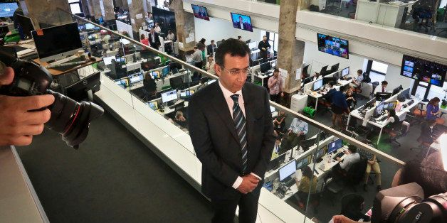 Ehab Al Shihabi, interim CEO for Al-Jazeera America, listens during an interview overlooking the newsroom, after the network'