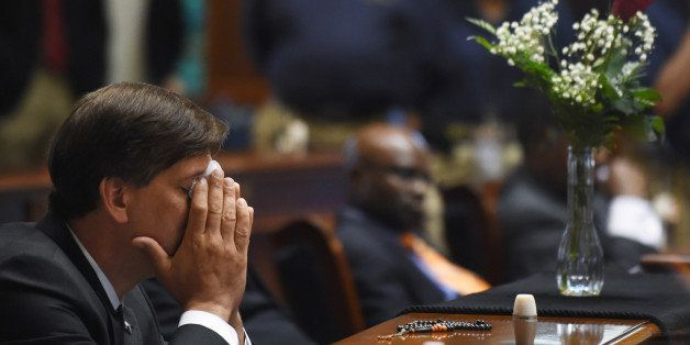 State Senator Vincent Sheheen (D-Kershaw) gets emtional as he sits next to the draped desk of state Sen. Clementa Pinckney, T
